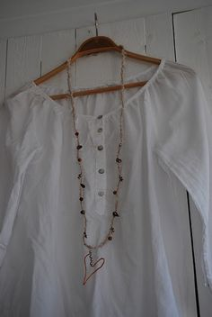 peasant blouse and long necklace