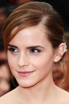 Emma Watson delivers a well-balanced look at the 2013 Cannes Film Festival Red Carpet. Who would've thought that an edgy earcuff could go so well with the classic side-party chignon? #beauty