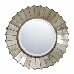 "Round wall mirror with an antique silver-finished scalloped wood frame.       Product: Wall mirror    Construction Material: Mirrored glass and wood    Color: Antique silver   Features:  Etched glass panels    Generous 1.25"" beveled edge   Dimensions: 32"" Diameter"