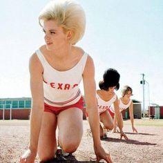 The University of Texas women's track team practices in March 1964 big hair even when running!