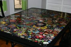 """""""I Spy"""" table - covered in colorful little toys and resin."""
