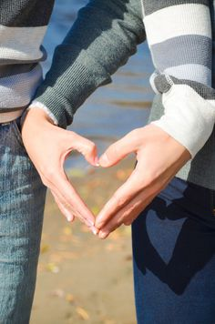heart shape with hands engagement photo