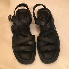 Black Leather Sandals Adorable black leather strappy sandals with silver buckle!!  Nicely padded for extra comfort!!  Only worn a couple of times!!  I am a true 6 1/2 and these fit me perfectly!!  NXP Shoes Sandals
