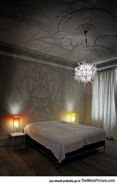 Chandelier Turns Any Room Into Haunted Woods. ~~> You say haunted woods, I say a peaceful forest. I want it. Now!