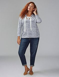 Oversized grommets steal the spotlight on this lace-up top. lanebryant.com