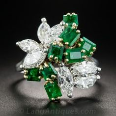 Seven bright white and sparkling marquise-cut diamonds, totaling 1.30 carats, mix it up with as many bright rich green emerald-cut emeralds in this strikingly beautiful cocktail ring, circa 1960s-70s, finely hand-fabricated in platinum (for the diamonds) and 18K yellow gold (for the emeralds). Splashy, flashy and fun! Currently ring size 6 1/4.