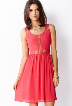 Love 21 - A chiffon dress featuring lace inlays. Round neckline. Sleeveless. Back zipper with hoo...