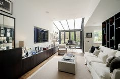 Fulham Road Townhouse: PEEK Architecture + Design.  Living Room - glass extension www.peekarchitecture.co.uk