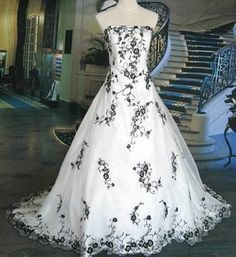okay, it's not all white, but i find it very unique and i'd just love to have something similar to this be my wedding dress :)