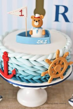 Nautical Birthday Party for your little sailor! Such a sweet party with a gorgeous cake and topper!