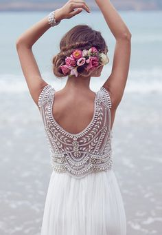 this bride has a beautiful dress and also a beautiful haircut