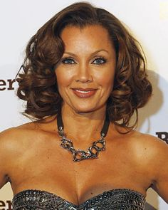Bouncy curls and rich, chocolate toned brunette hair color on Vanessa Williams. Find your own flattering hair color match at home @ www.eSalon.com