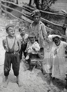 http://media.gettyimages.com/photos/poor-children-with-disrupted-clothes-photograph-around-1935-picture-id107876533