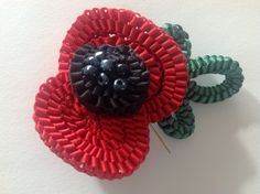 Kelanash Poppy created using satin ribbon by the designer Irene McCarthy,you can purchase in kit form Irene, Poppy, Jewelery, Beading, Ribbon, Satin, Kit, Projects, Design