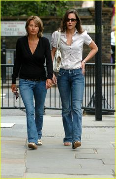 Kate Middleton goes for a walk with her mom on Monday morning, the day after the Concert for Diana