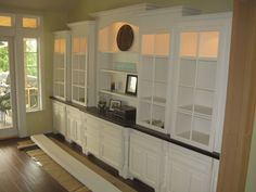 beautiful built-ins for the dining room. use glass shelves