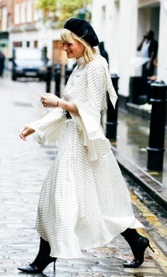 Spring street style outfit ideas: Who wouldn't want to wear a polka dot monochrome dress with a black beret right now?