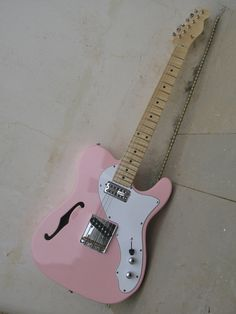 A sissy One: Fender Telecaster, actually a Fender Thinline semi-hollowbody. Single F hole in the top. Generally comes with 2 Guitar Pics, Music Guitar, Cool Guitar, Acoustic Guitar, Fender Squier Telecaster, Fender Guitars, Pink Guitar, Elvis Presley, Fender Custom Shop