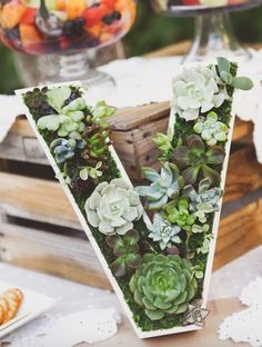 You can fashion succulents in the shape of your monogram as a centerpiece.