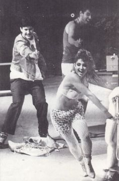 Madonna + Beastie Boys.. i think they are shooting water guns at her in a bra? sounds about right