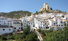 Velez Blanco, Almeria, Spain. A view of the castle standing above the ancient town, with a maze of narrow lanes spreading out from its base. The castle was once a Moorish alcazaba, after it fell to the Christians it was later built on and  extended by the Marquises of Vélez Blanco in the early 16th century. Entry is free and well worth a visit, the interior is being restored as most of it was sold off one way or another.