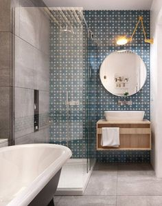 The patterned tile adds visual interest. Love the industrial elbow light, can be angled to provide mood or task lighting.