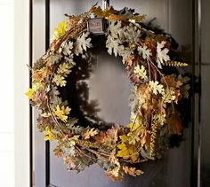 "Faux Pin Oak Wreaths FAUX PIN OAK WREATHS  $149.00 SALE $88.99 A naturalistic showcase recalling fall's abundant foliage makes a welcoming harvest statement. Featuring faux leaves interlaced with real twigs, our wreath celebrates the changing colors of autumn.  Small Wreath: 22"" diameter  Large Wreath: 33"" diameter  Made of Styrofoam, polyester, wire and plastic and twisted around a natural twig frame.  Backed with a small loop for wall mounting. @ Pottery Barn"