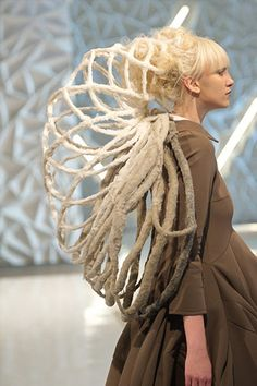 Wearable Sculpture - earthy, architectural fashion design with a 3D cage-like…
