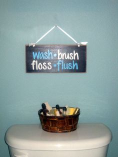 Think I can diy this! With leftover paint on canvas using a stencil. Wash Brush Floss Flush  Kids' Bathroom Sign by selahcustomsigns, $15.00