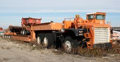 1970 MACK M100SX : haul 1000 tons, trailer payload 650 tons - Pile Foundations Construction, Hicksville, New York. (still fully operational)