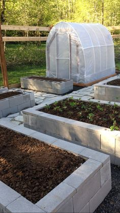 Our garden! 8 foot deer fence, cinder block raised bed, organic soil, flagstone and crushed glass pathway, and a hoop-house.