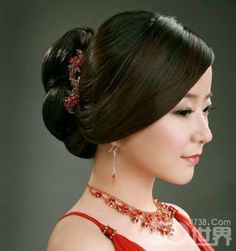 pretty jewelry and simple up-do and red dress.