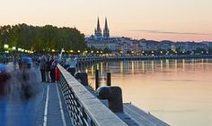 Shoreline of the Garonne RiverThe shoreline of Bordeaux, the Garonne River with the twin towers of the 'Eglise Saint Louis des Chartrons' at sunset
