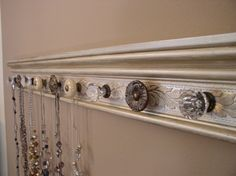 Trim board painted with decorative cabinet knobs for hooks diy