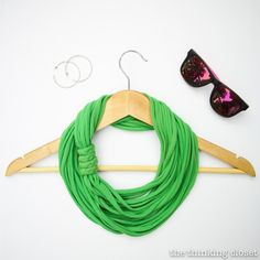 I love this T-shirt scarf/necklace. 15 mins, no sewing. Just think of all those old t-shirts...hmm. Fashion accessories!