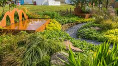 See Capable of Reinvention Garden at RHS Hampton Court Palace Flower Show / RHS… Hampton Court Flower Show, Rhs Hampton Court, Garden Bridge, Palace, Outdoor Structures, Gardening, Brown, Flowers, Lawn And Garden