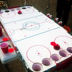 This air hockey version of beer pong is not only different, but awesome! This is a sure way to get everyone excited, (seeing as most people love air hockey), and an easy way for teams to compete. Canadian Beer, I Am Canadian, Canadian Things, Canadian People, Fun Games, Party Games, Beer Games, Redneck Games, Party Fiesta
