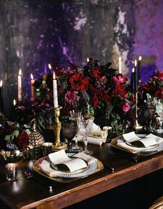 This deep, dark and moody reception is perfect for a winter wedding. We love the dramatic black and white taper candles