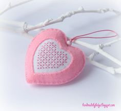 Pink hearts decorated with cross-stitch