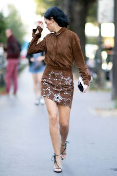 Brown coated shirt and skirt with metallic accents, a pair of high heels and your look is perfect. Spotted on the Fashion Week of Paris