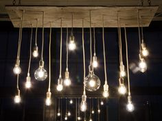 Reclaimed Barn Wood Chandelier with varying Edison bulbs Whitewash I would make this, but in a donut shape, not a rectangle. Cabin Crafts, Barn Wood Crafts, Barn Wood Projects, Wood Chandelier, Chandeliers, Pub Design, Aging Wood, Reclaimed Barn Wood, Hanging Lights