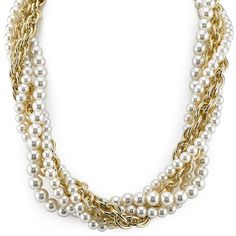 A fierce accessory for the fashion fearless. Strands of faux pearls and bold gold-toned chains intertwine to create a flaunt-worthy statement piece.