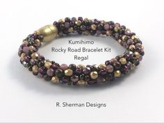 Complete kit contains nearly everything you need to create the Kumihimo Rocky Road Bracelet in Regal (Purples and Gold), and featuring Fire Polished beads  Techniques used: 8 warp cord Kongo Gumi (beaded round braid) Braiding around a core. Prior experience with Kumihimo braiding with beads is essential, but if you havent previously used a core in your braiding, the included pattern provides instruction. Its easy!  Kit includes: - Complete tutorial with bead loading pattern, tips, and…