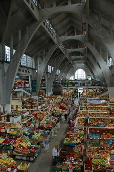Market Hall - Wroclaw, Dolnoslaskie Poland. I love the contrast between the bleak grey concrete and the vibrant market goods below!