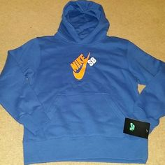 Boys Nike SB hoodie pullover sz medium NWT New with tag Nike SB sweatshirt.   Youth size medium, 10 - 12 yrs, 140 - 152 cm. Cotton / polyester blend.   Color varsity royal.  Please check my other listings. Thank you for looking and have a great day! Nike Jackets & Coats