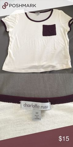 NWOT baby tee/crop top Never been worn NWOT Charlotte Russe baby tee crop top. It's a cream color with burgundy pocket and neck and sleeve lining. Very soft. Charlotte Russe Tops Crop Tops