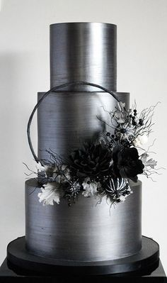 This is one sexy, dark, shimmery wedding cake! I'm digging that gunmetal shine a… This is sexy, dark, shimmery wedding cake! I'm digging that gunmetal shine and the black and white sugar flower decor! Black Wedding Cakes, Floral Wedding Cakes, Amazing Wedding Cakes, Elegant Wedding Cakes, Wedding Cake Designs, Wedding Cupcakes, Wedding Flowers, Trendy Wedding, Summer Wedding