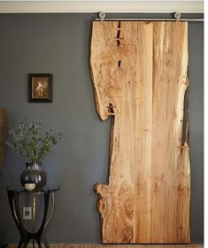 Reclaimed Wood Slab on barn door hanger: Truly a unique wall hanging.....beautiful actually! Freshome