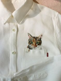 Hiroko Kubota - One example of many cats Kubota hand embroidered onto pockets of shirts for her son. (who was enamored with cats)