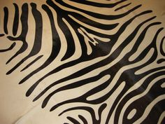 Zebra pattern printed #hide carpet! We have three large #zebra print in stock and on #sale with dark brown stripes on beige or black!
